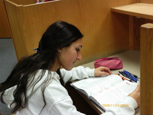 Senior Taynya Bagheri goes to the Potomac library to study AP Biology without distractions commonly found in other places. The library also provides multiple resources, like the quiet study room pictured above.