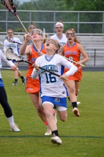 Girls lax pulls out winning season, upset in playoffs