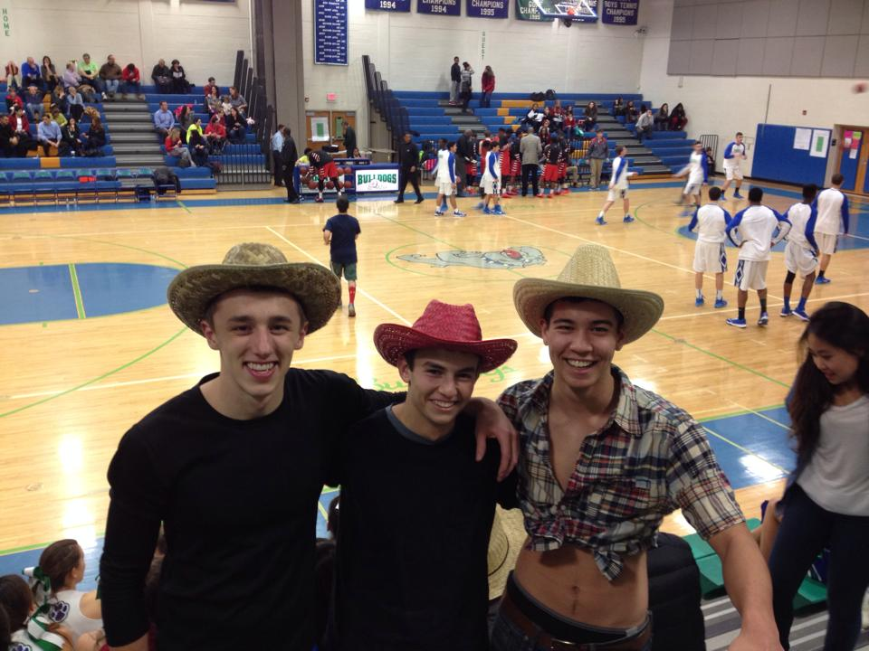 Seniors Erik Johnson, Justin Spivack and Chris Hallock all support the boys basketball team on Dec. 23.