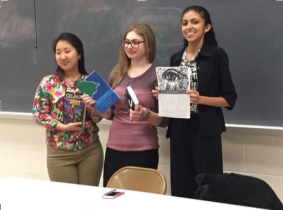 Clarksburg HS senior Dahlia Huh (left) and CHS seniors Sammi Silber and Elina Kapoor (center and right) display their books at Student Author Night.