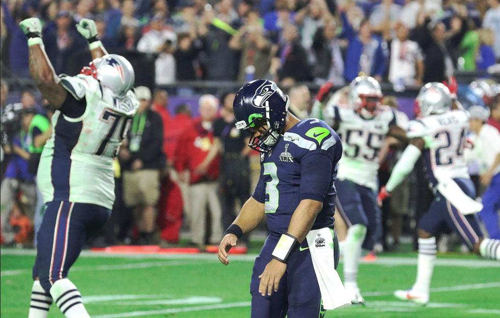 Seattle Seahawks quarterback Russell Wilson drops his head after throwing an interception on the Patriots one yard line.