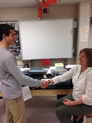 Senior Danny Gordon consults with his teacher for a recommendation.