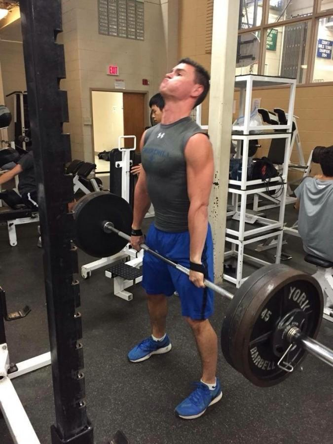 Health and Fitness Club President and founder Elliott Sloate demonstrates proper lifting technique.