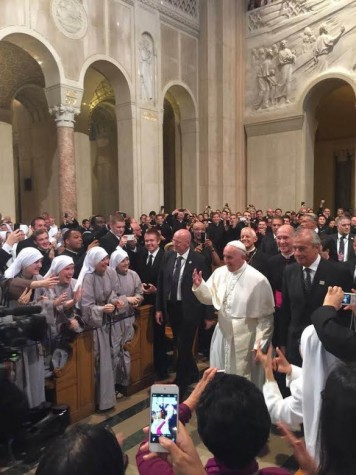 The Pope greets the adoring crowd at his reception.