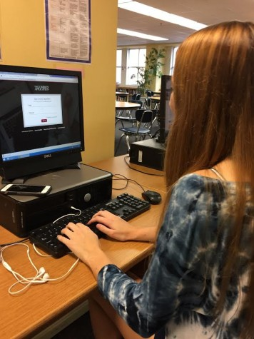 Senior Brittney Burwell logs into her Common Application account.