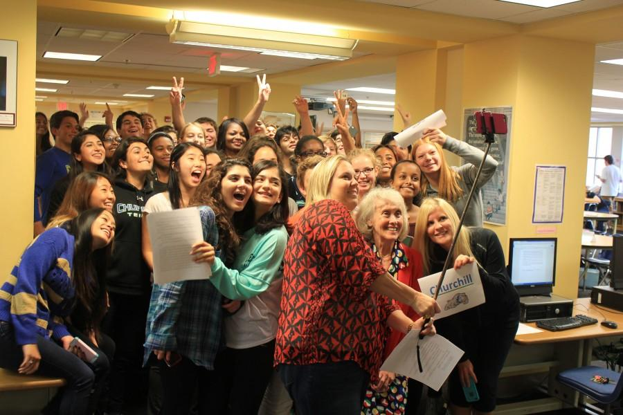 Students gather in the media center to take a selfie that sets a new world record.