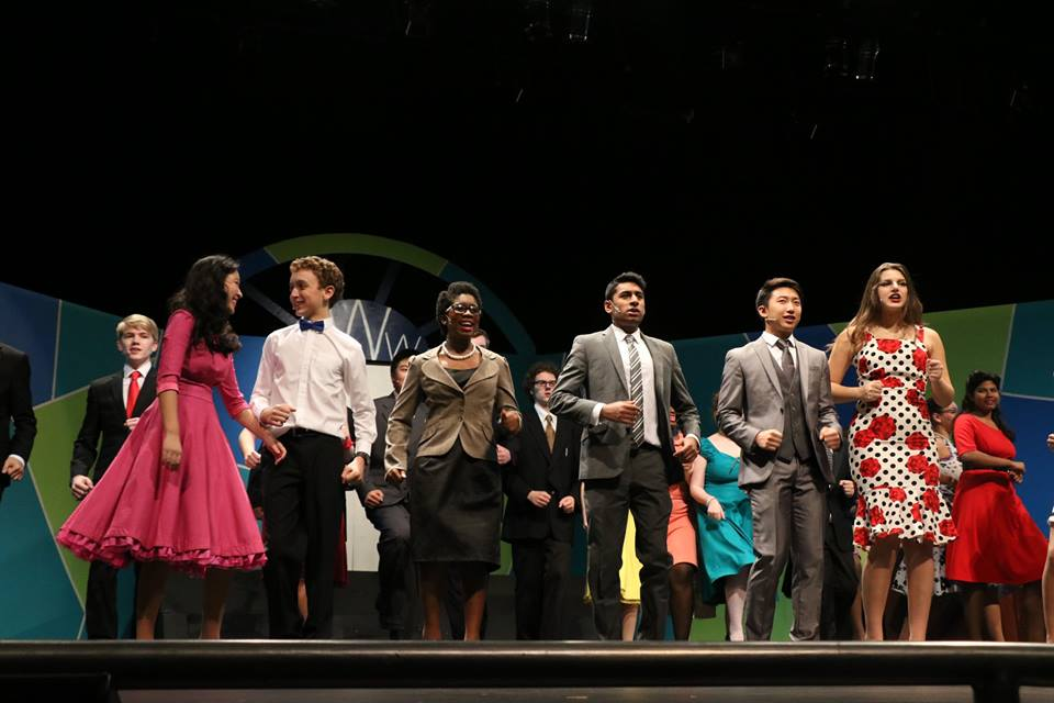 The How to Succeed in Business Without Really Trying cast performs on stage during a dress rehearsal. The show opened Nov. 13.