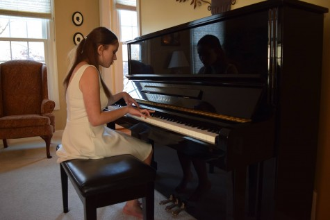 Safdie plays the piano as she records her music video for