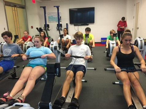 Members of the crew team workout in Erg machines to prepare for their spring season, which consists of shorter, 1.4 mile races.