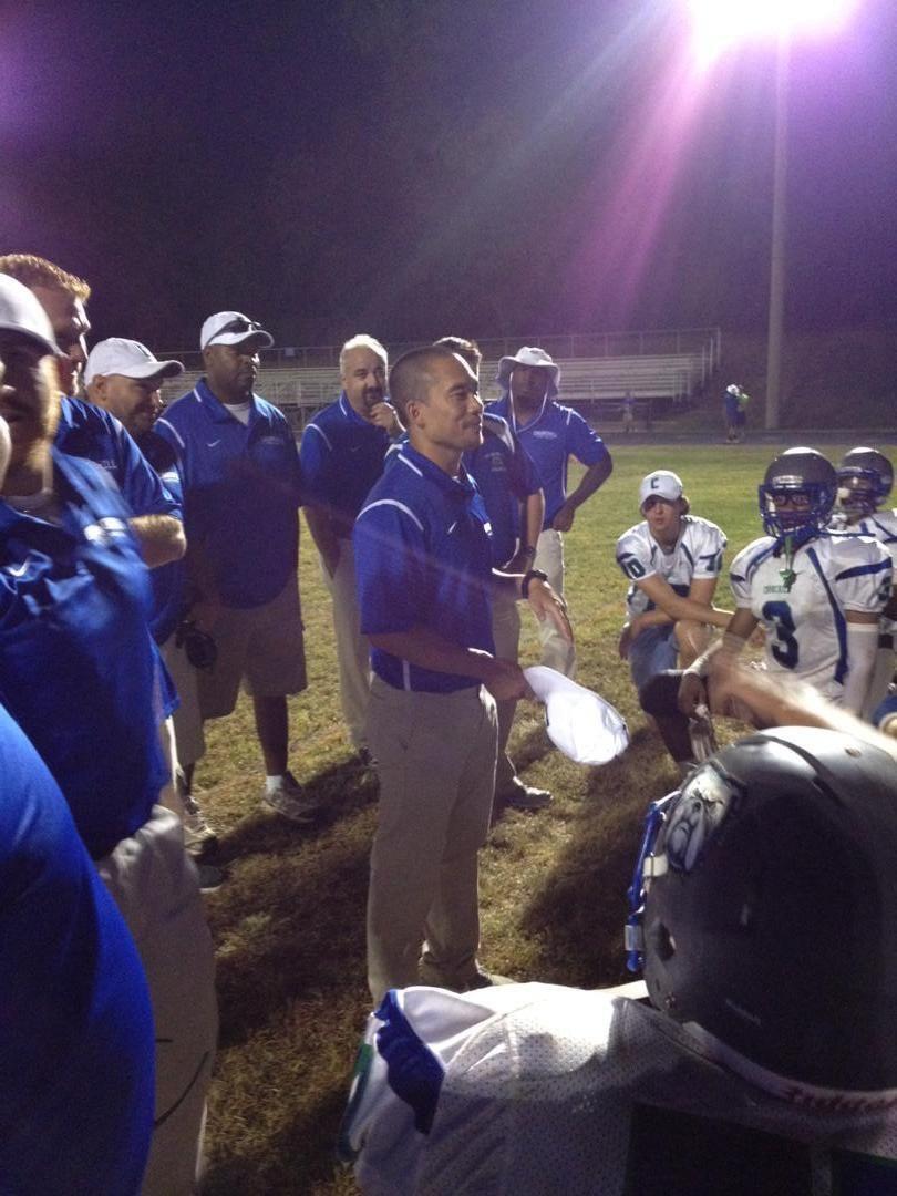 English teacher and football head coach Albert Song gives the team a pep talk before a game.