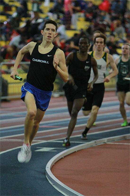 Senior Michael Hughes runs his leg of the relay.