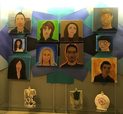 Studio One art students display their talent for portraits outside the art rooms.