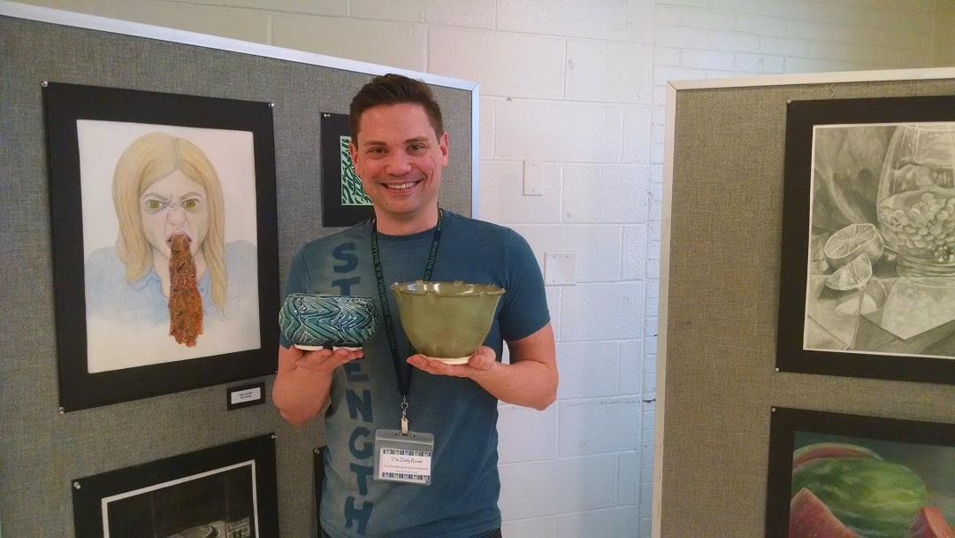 Art Department resource teacher Brendan Roddy displays original pottery that will be raffled off during the Arts Festival  April 19-29.