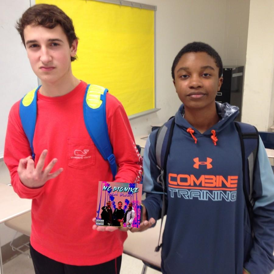 Sophomores Green and Daniels pose with Daniels' album.