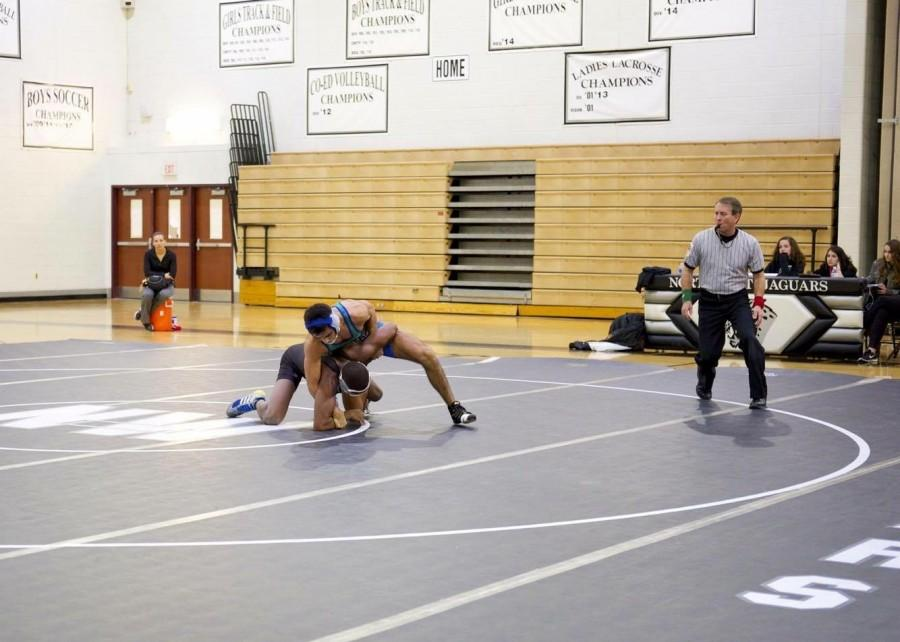 Senior captain JJ Bravo sets an example for his wrestling teammates as he gets ready to take on his opponent. Bravo has led the team this season to a 26-6 record in tournaments and a 10-4 record in dual meets.