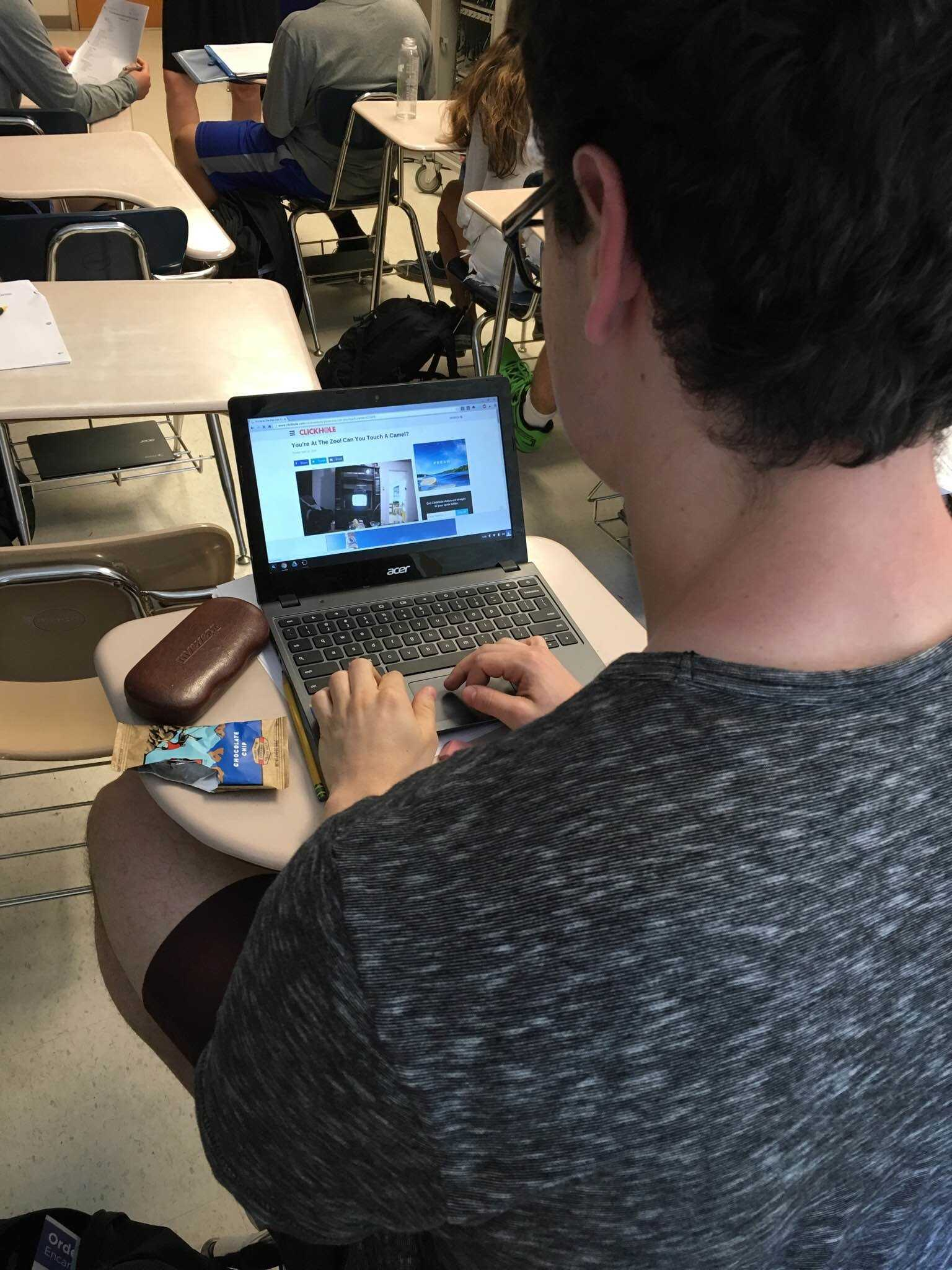 Senior Elliot Sloate  gets distracted by games on his chromebook during a class.