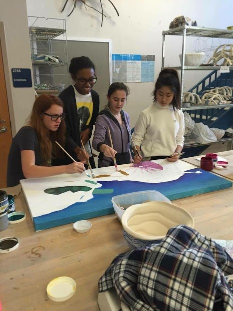 Seniors Josie Scriven, Jessica Dibble, Carly Rosenfeld and Sophia Kim paint sea creatures.