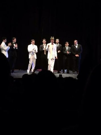 Senior Jake Certner accepts his crown after emerging victorious from the annual Mr. Churchill competition.