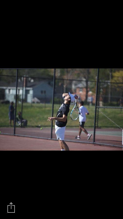 Senior+Mark+Dager+serves+the+ball+during+a+match.+Dager+and+his+doubles+partner+Austin+Yang+won+their+doubles+bracket+at+counties.