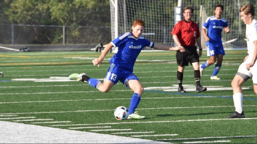 Senior captain Jack Stern kicks the ball in a recent game. The boys soccer team is off to a 4-1-2 start and hopes to make it deep into the playoffs this year.