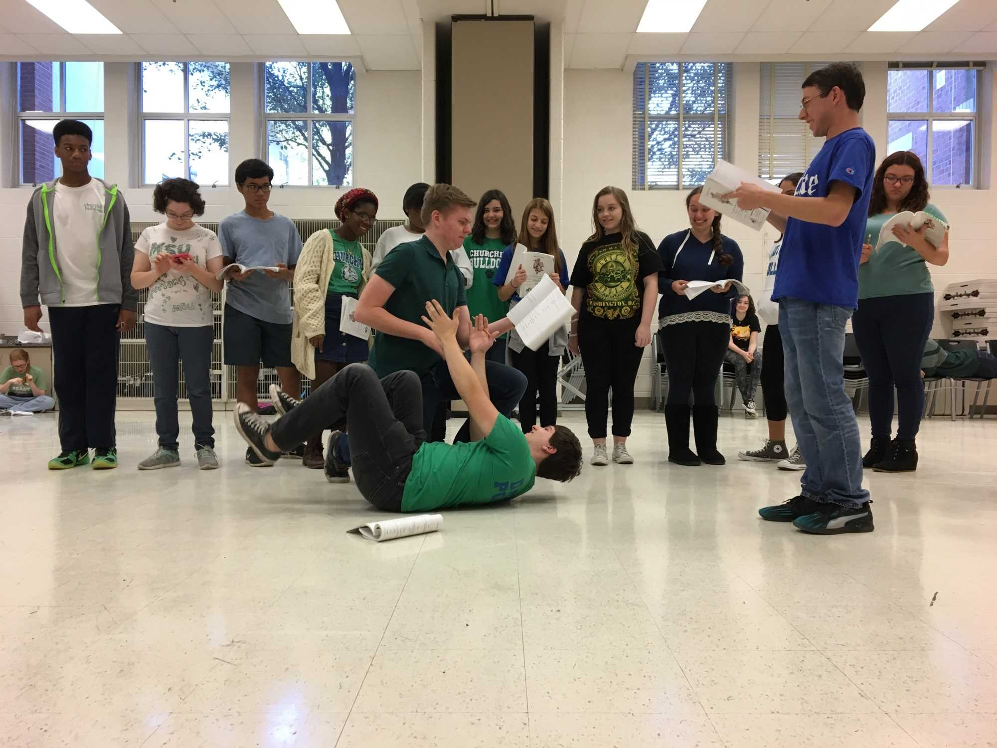 """Junior Nick Schaap, Senior Alex Scott and members of the cast of """"A Funny Thing Happened on the Way to the Forum"""" rehearse a scene."""
