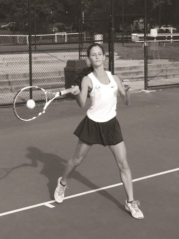 Sopomore Sofia Hahn hits the ball during a tennis match. The girls tennis team placed second at counties and credits their success to hard work at practice and strong leadership from their captains.