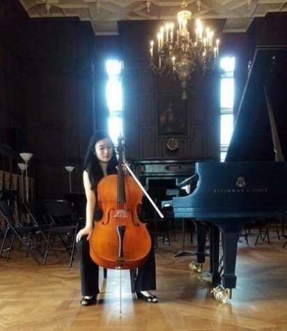 Senior Jenna Wang takes a break from playing the cello. She has been playing for many years and hopes to pursue her music further.
