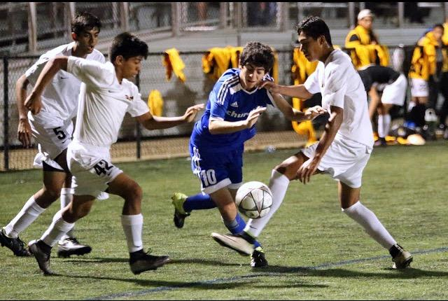 Junior Darius Siahpoosh takes the ball up the field.