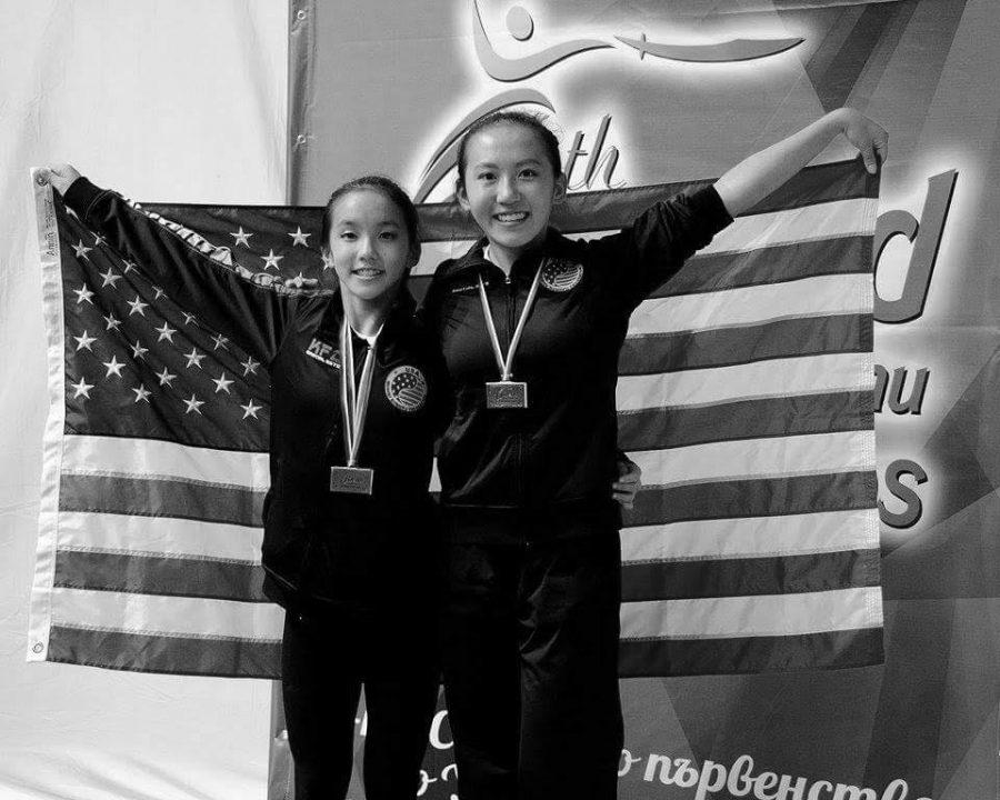 Sisters Mia Tian and Lucy Lee pose after winning medals in Bulgaria.