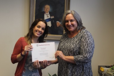 Beheler (left) accepts her award for being recognized an exceptional teacher by Stanford University alongside Laclef (right).