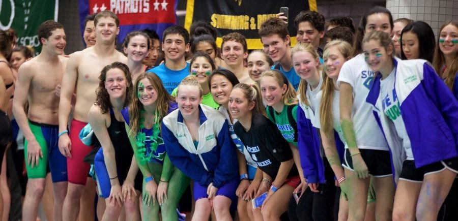 Members+of+the+CHS+Swim+and+Dive+team+pose+on+the+pool+deck+after+a+meet+last+season.+Last+year%2C+the+girls+team+finished+the+season+undefeated+and+the+boys+team+finished+in+second+place.