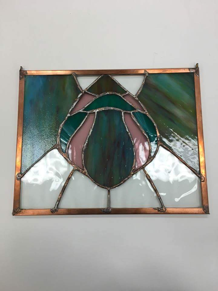 Joelle Goldberg created a stained glass piece for last year's Consensus chain. The theme was the Montgomery County Agricultural Fair.