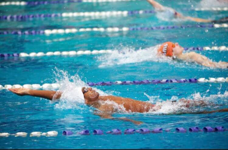 Junior Sanjay Wijesekera swims the backstroke in a meet. He placed fourth in the 100 yard event last year.