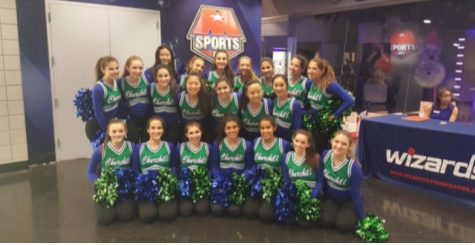 The poms team poses for a picture in Verizon Center.