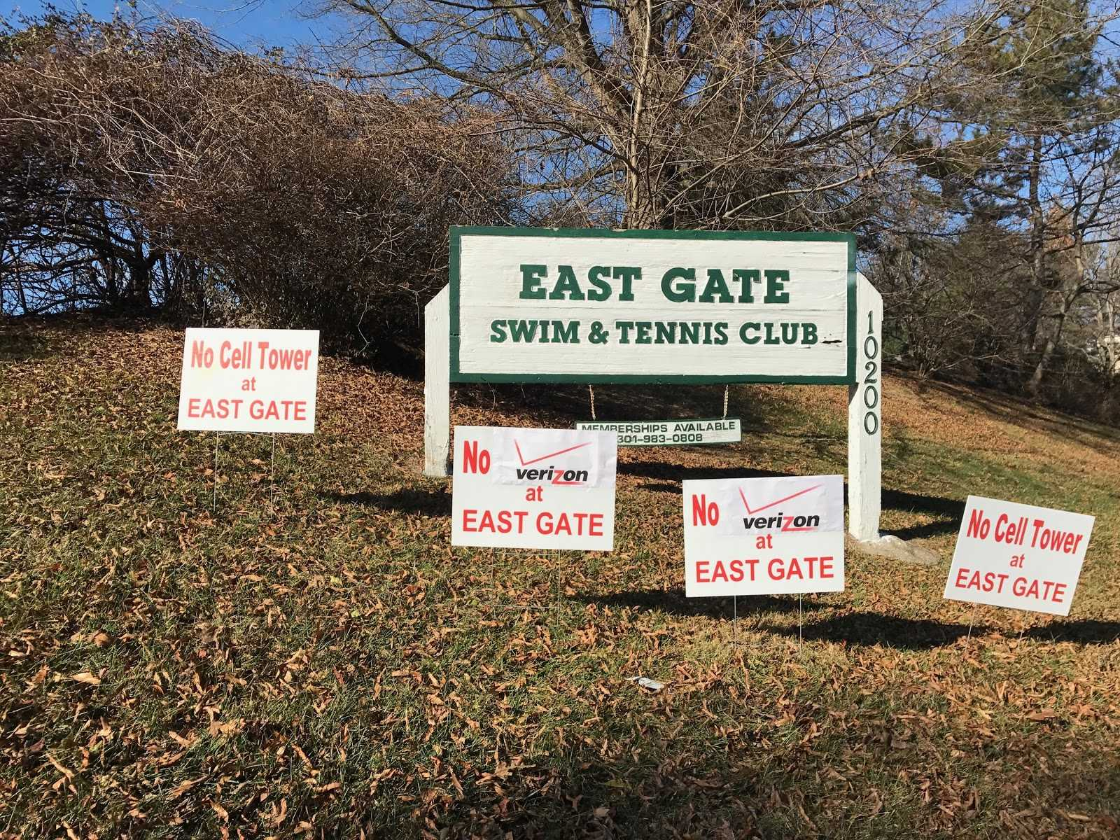 Signs have been put up at the East Gate Swim and Tennis Club in protest of the proposed Verizon Wireless cell phone tower.