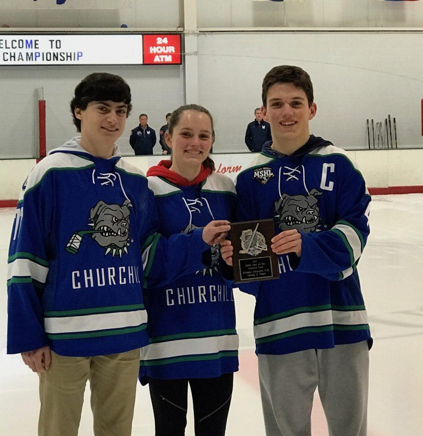 Juniors Ben Stanish, Kate Danziger and Cameron Miller accept the MSHL academic award during the pre-game ceremonies of the varsity hockey state-championship game.