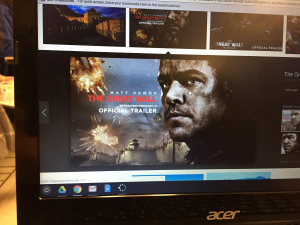 A movie poster of The Great Wall is seen on a CHS student's screen.