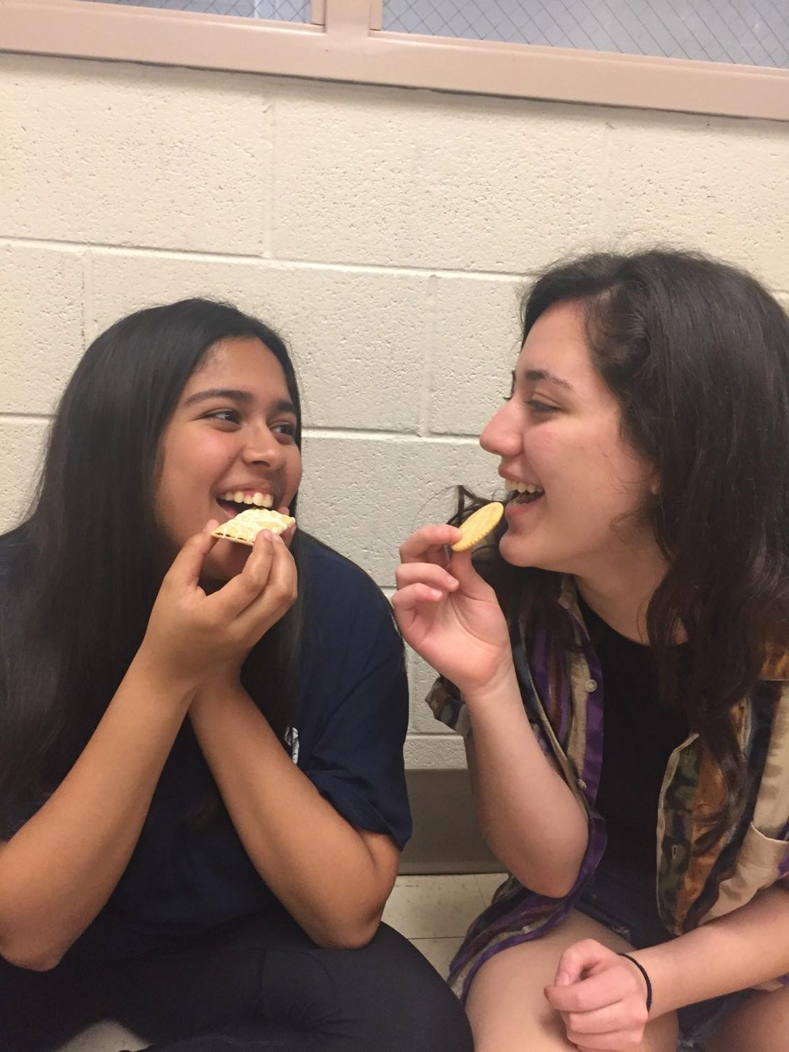 Two CHS students participate in Mukbanging, a common form of ASMR, in which people eat and record the sounds of chewing food. ASMR has become popular among teenagers on social media.