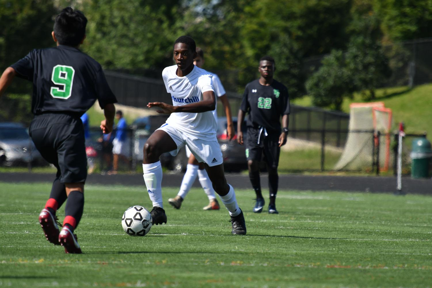 Senior Shawn Diboti-Lobe goes against players from Walter Johnson during boys soccer's Sept. 29 game. CHS won 2-0 against  WJ.