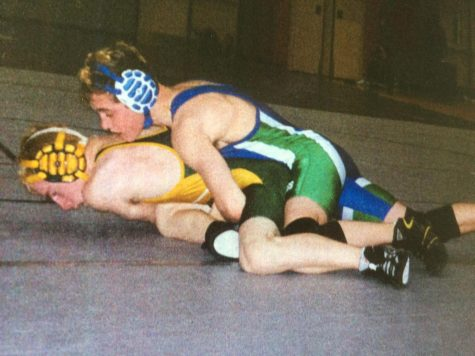 WCHS 2002 alumnus David Kraus pins his opponent during a wrestling meet.