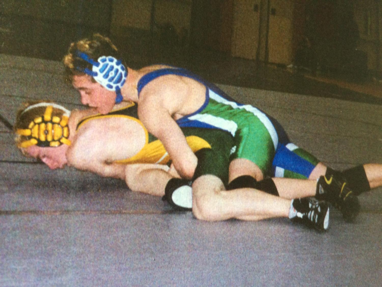 WCHS 2002 alumnus David Kraus pins his opponent during a wrestling meet.