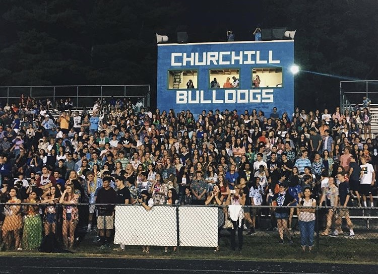 The+student+section+was+packed+with+students+from+all+grades+at+the+Sept.+21+football+game+against+Whitman+HS.+Students+donned+Hawaiian+attire+to+partake+in+the+themed+game.
