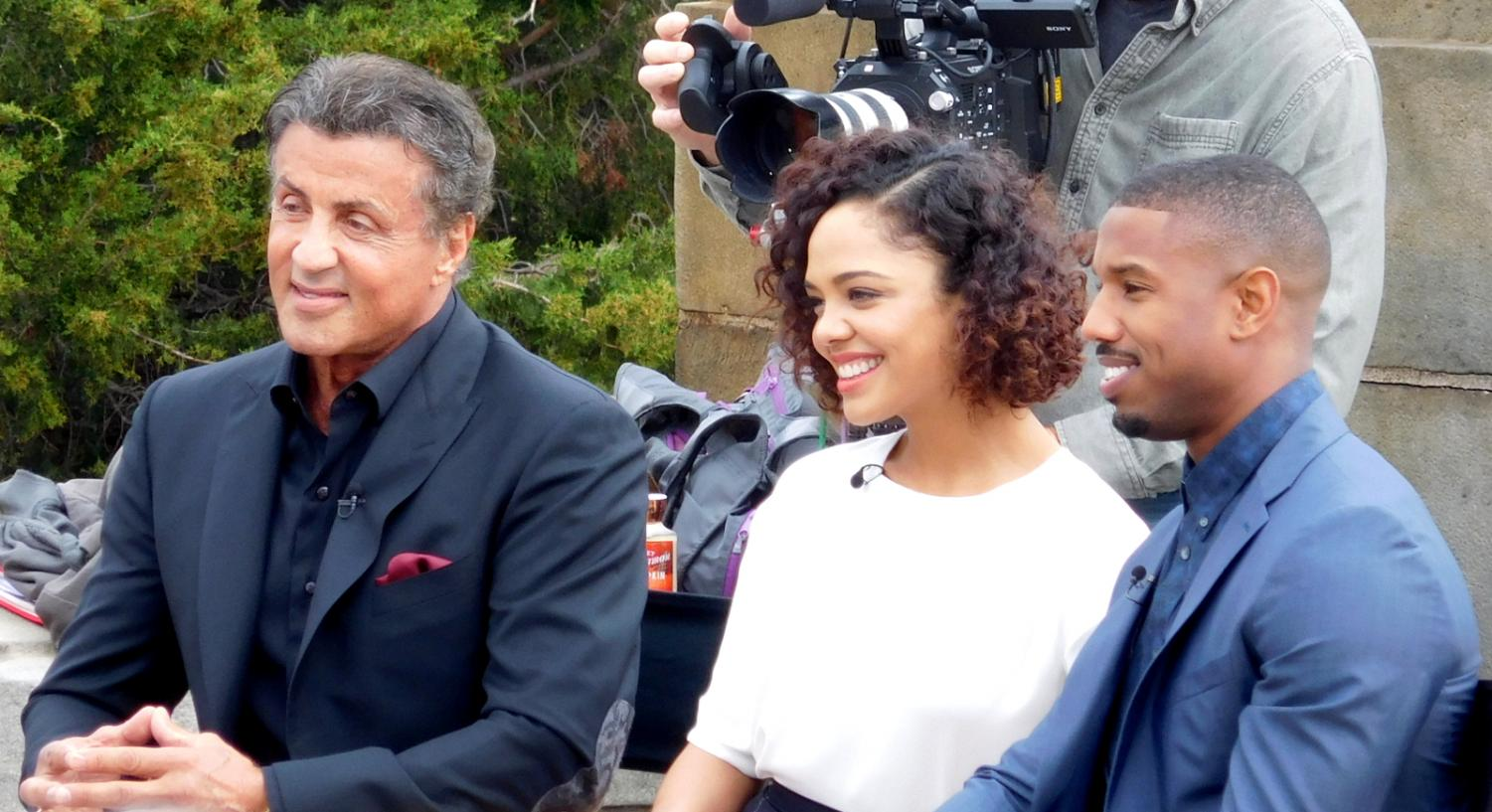 Michael B. Jordan, who plays Adonis Creed poses with fellow actors Tessa Thompson and Sylvester Stallone.