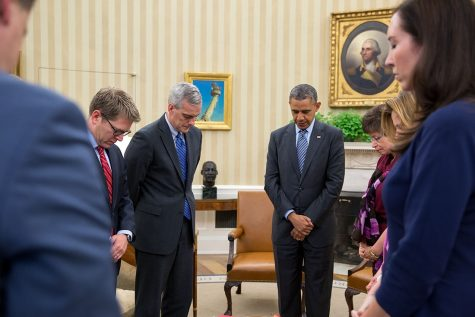President Barack Obama and his cabinet staff participate in a moment of silence after the Sandy Hook Elementary School shooting 2012.