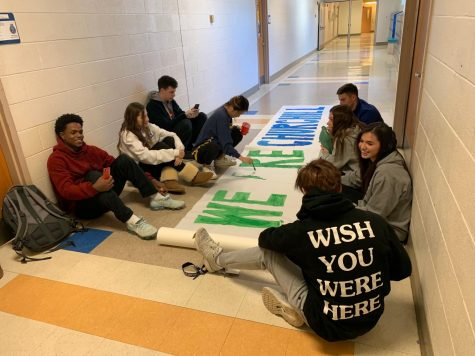 Students in leadership class work to promote a united WCHS community through artistic pieces such as banners. Also, a new advisory period will take place once a month for students and staff to discuss grade level and community-wide issues.