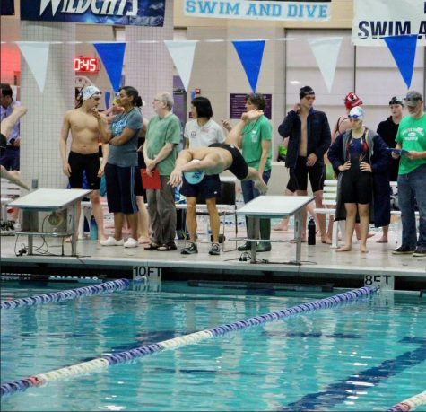 John Nguyen explodes off the blocks as he begins to swim.