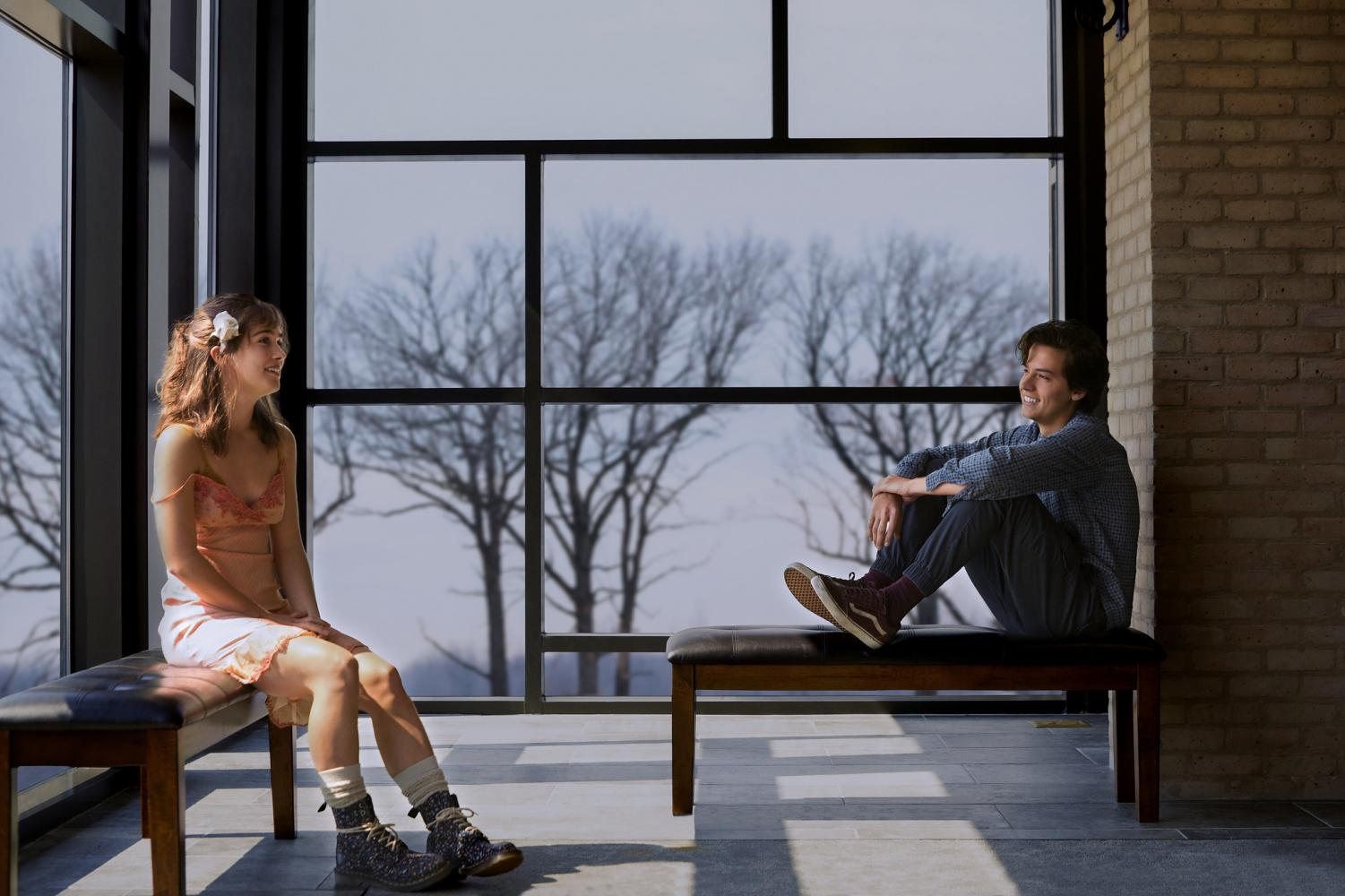 Haley Lu Richardson (left) and Cole Sprouse (right) portray two teens with a powerful connection in the romantic drama film Five Feet Apart.