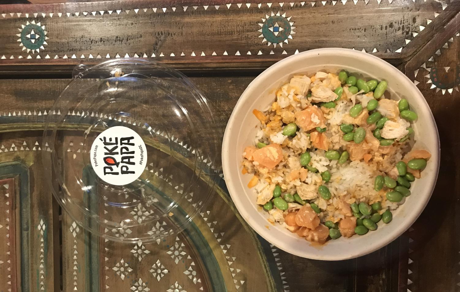 This is an example of an order at Poké Papa, including salmon, diced chicken, white rice, edamame, sweet shoyu sauce, and sriracha sauce.