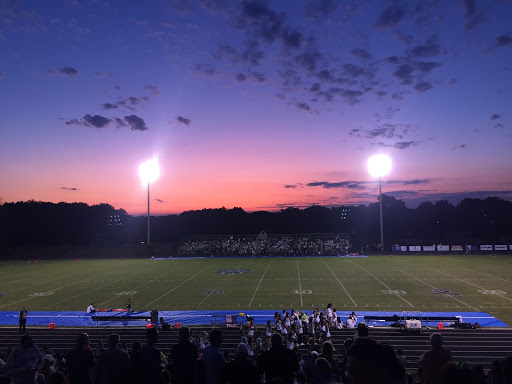 The sun sets during WCHS home opener football game vs Walter Johnson on Friday, September 6, 2019. It costs $3 for students to attend the game