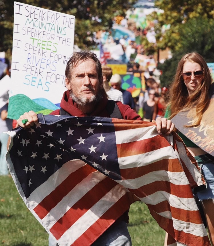Senior Hannah Roberts captures photos of activists at the Climate Strike this past Sept 20 through her photography. The Climate Strike is one of the many series of strikes and protests to demand action against the impending dangers of climate change.